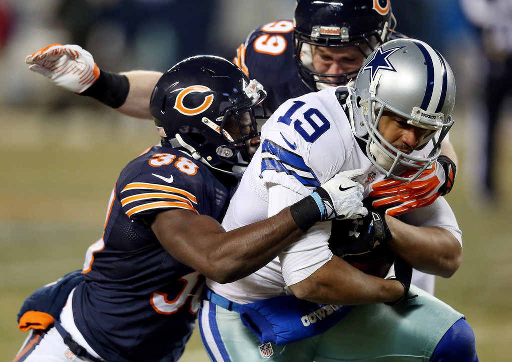 . Wide receiver Miles Austin #19 of the Dallas Cowboys is tackled by cornerback Zack Bowman #38 and defensive end Shea McClellin #99 of the Chicago Bears during a game at Soldier Field on December 9, 2013 in Chicago, Illinois.  (Photo by Jonathan Daniel/Getty Images)