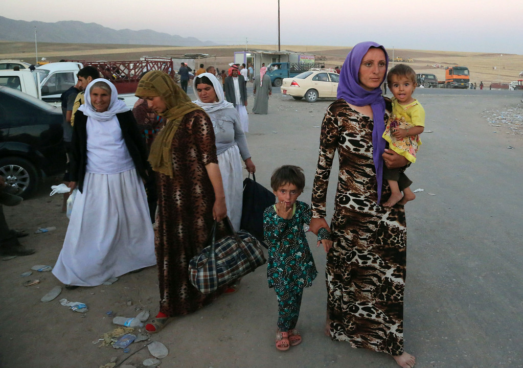 . Displaced Iraqis from the Yazidi community arrive to the camp of Bajid Kandala at Feeshkhabour town near the Syria-Iraq border, Iraq Saturday, Aug. 9, 2014. (AP Photo/ Khalid Mohammed)