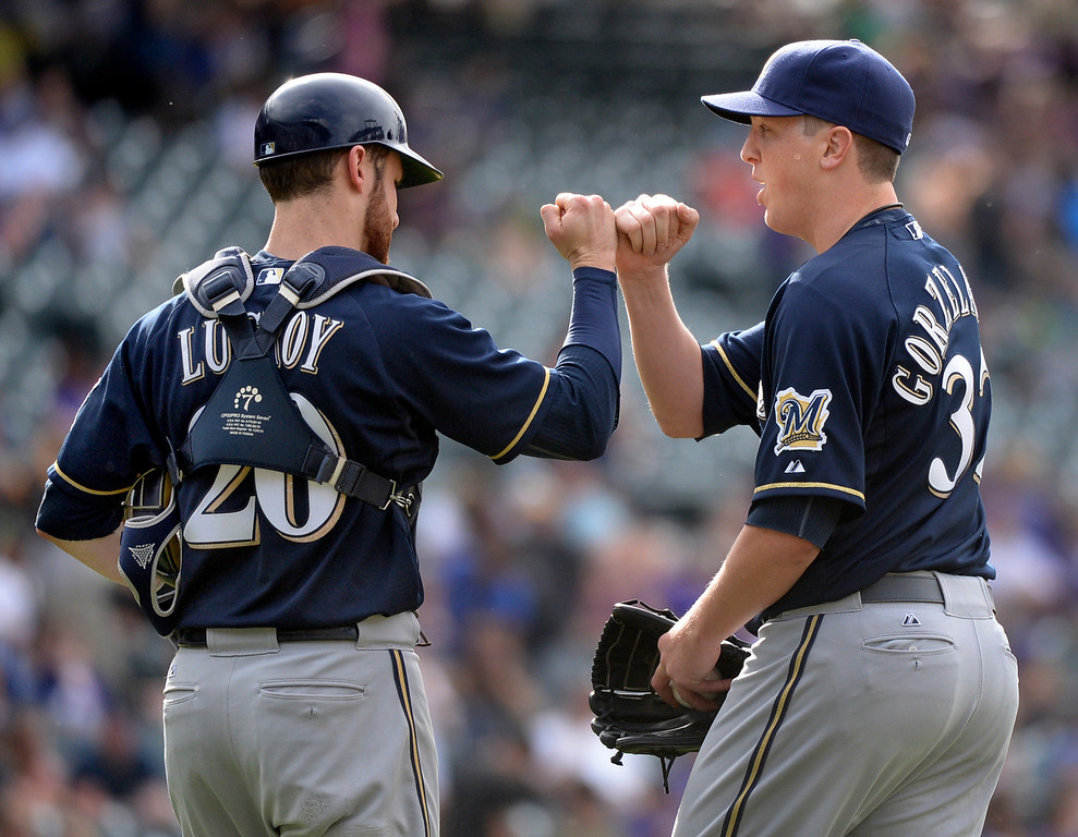 . DENVER, CO - JUNE 20: Milwaukee catcher Jonathan Lucroy and reliever Tom Gorzelanny celebrated the win Saturday. Gorzelanny came in to face one batter in the ninth inning, and retired Colorado\'s Charlie Blackmon. The Milwaukee Brewers defeated the Colorado Rockies 9-4 at Coors Field Saturday afternoon, June 21, 2014. Photo by Karl Gehring/The Denver Post