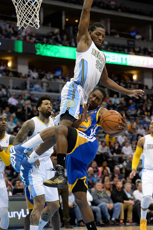 . DENVER, CO - APRIL 16: Golden State Warriors guard Jordan Crawford (55) runs in to Denver Nuggets forward Kenneth Faried (35) during the fourth quarter April 16, 2014 at Pepsi Center. Golden State Warriors defeated the Denver Nuggets 116-112. (Photo by John Leyba/The Denver Post)