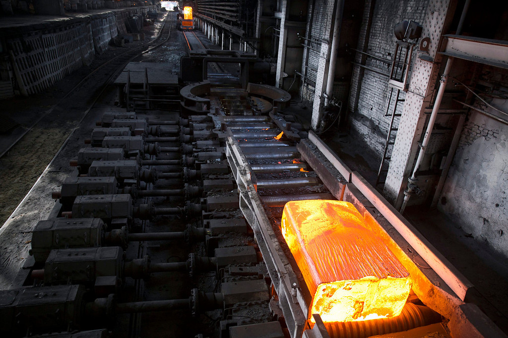 . A newly forged steel ingot passes along the production line inside the Zaporizhstal steel plant, owned and operated by Metinvest BV, at their site in Zaporizhzhya, Ukraine, on Monday, Oct. 15, 2013. Metinvest BV, Ukraine\'s largest steelmaker, last year acquired 49.9% in steelmaker Zaporizhstal a manufacturer of semi-finished steel products, including hot and cold-rolled plates and coils. Photographer: Vincent Mundy/Bloomber4