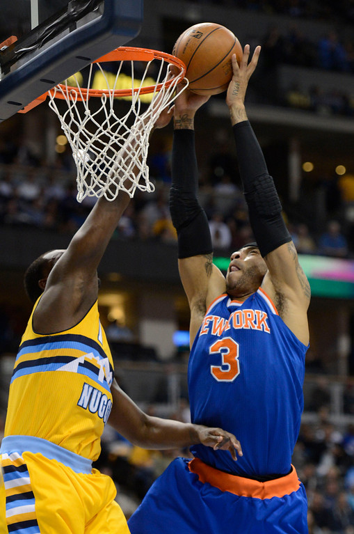 . DENVER, CO. - MARCH 13: Kenyon Martin (3) of the New York Knicks gets fouled by Jordan Hamilton (1) of the Denver Nuggets during the fourth quarter March 13, 2013 at Pepsi Center. (Photo By John Leyba/The Denver Post)