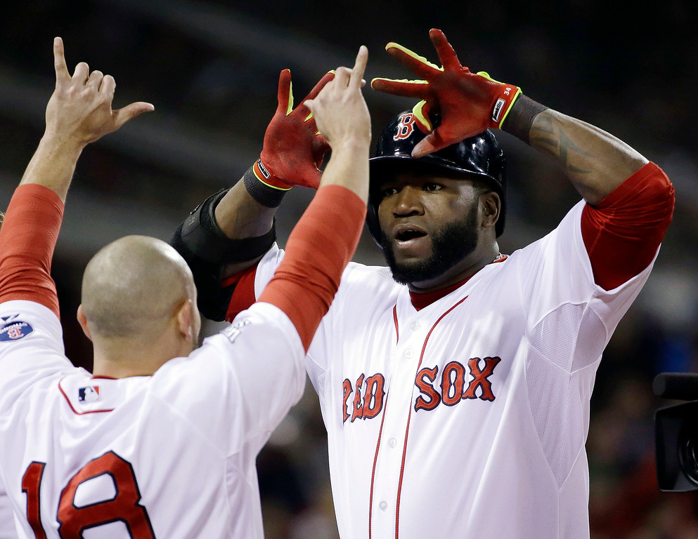 . Boston Red Sox\'s Shane Victorino (18) congratulates David Ortiz after Ortiz\'s two-run home run during the sixth inning of Game 2 of baseball\'s World Series against the St. Louis Cardinals Thursday, Oct. 24, 2013, in Boston. (AP Photo/David J. Phillip)