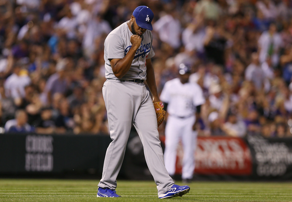 . Los Angeles Dodgers relief pitcher Kenley Jensen reacts after retiring the Colorado Rockies in the ninth inning of the Dodgers\' 3-2 victory in a baseball game in Denver, Thursday, July 3, 2014. (AP Photo/David Zalubowski)