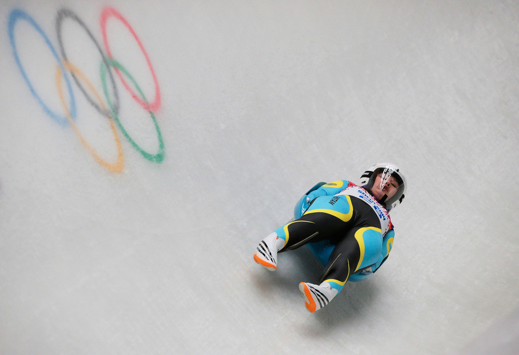 . Yelizaveta Axenova of Kazakhstan makes a run during the Women\'s Luge Singles on Day 3 of the Sochi 2014 Winter Olympics at Sliding Center Sanki on February 10, 2014 in Sochi, Russia.  (Photo by Adam Pretty/Getty Images)
