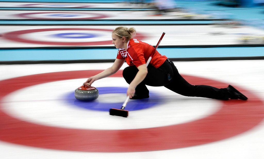 . Denmark\'s Jeanne Ellegaard delivers the rock during the women\'s curling match against South Korea at the 2014 Winter Olympics, Sunday, Feb. 16, 2014, in Sochi, Russia. (AP Photo/Wong Maye-E)