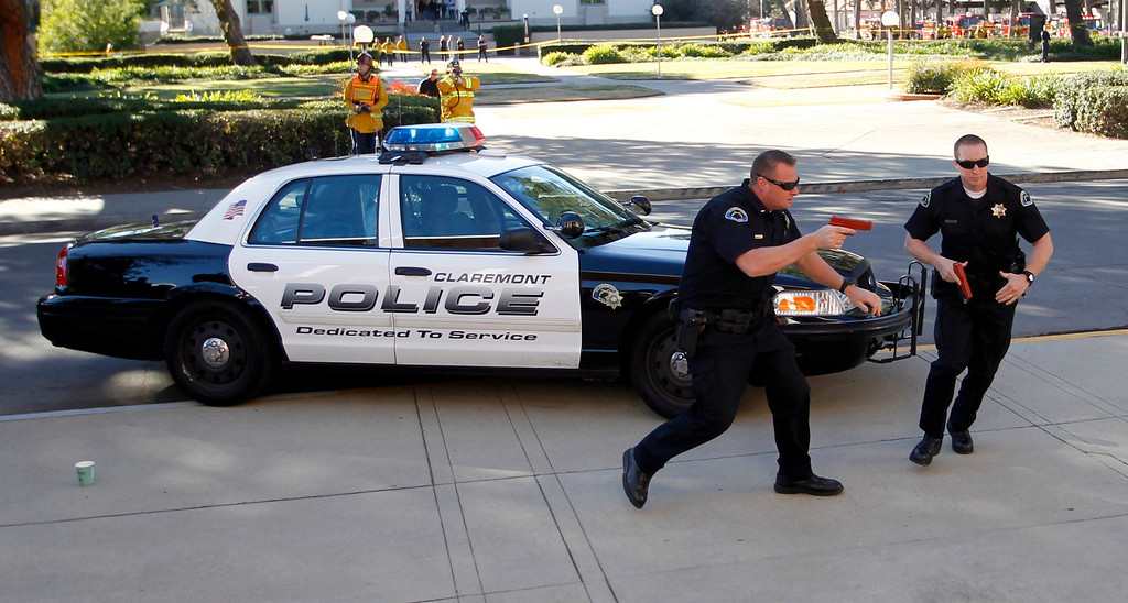 . Claremont police officers are the first to respond to a drill with the Los Angeles County Fire Department and Sheriff\'s Department, to conduct a training exercise at Scripps College in preparation for a school shooting in Claremont, California January 16, 2013. REUTERS/Alex Gallardo