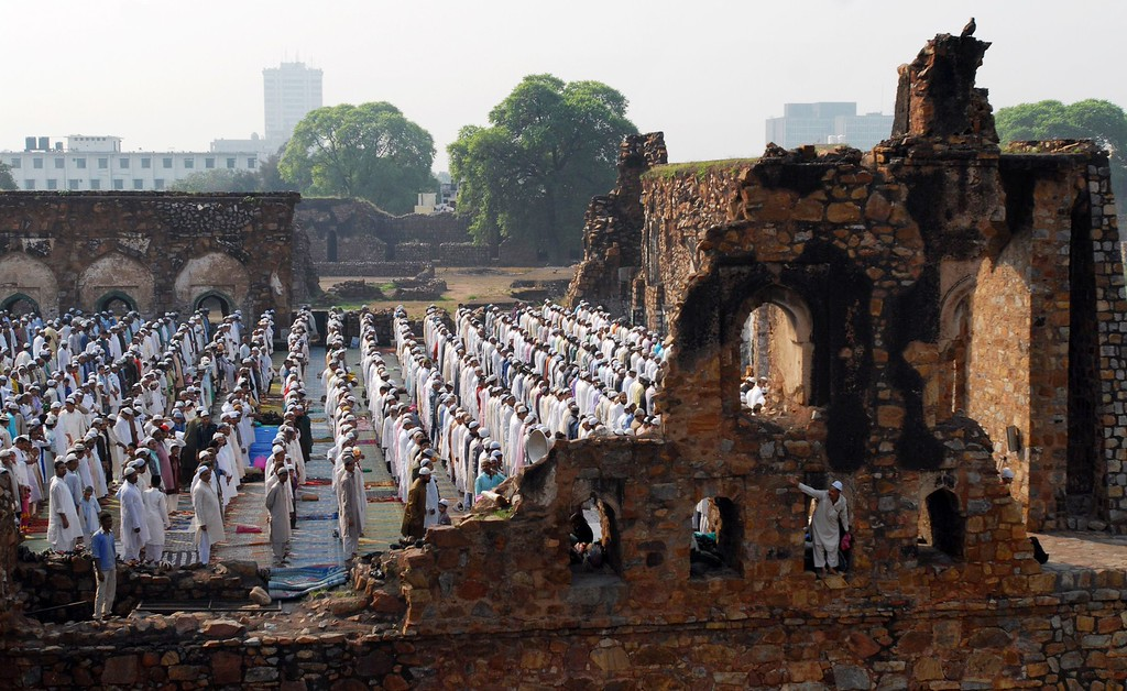. Indian Muslim devotees pray during the festival of Eid al-Adha at Feroz shah Kotal Fort and Mosque in New Delhi on October 16, 2013.  AFP PHOTO/ RAVEENDRAN/AFP/Getty Images