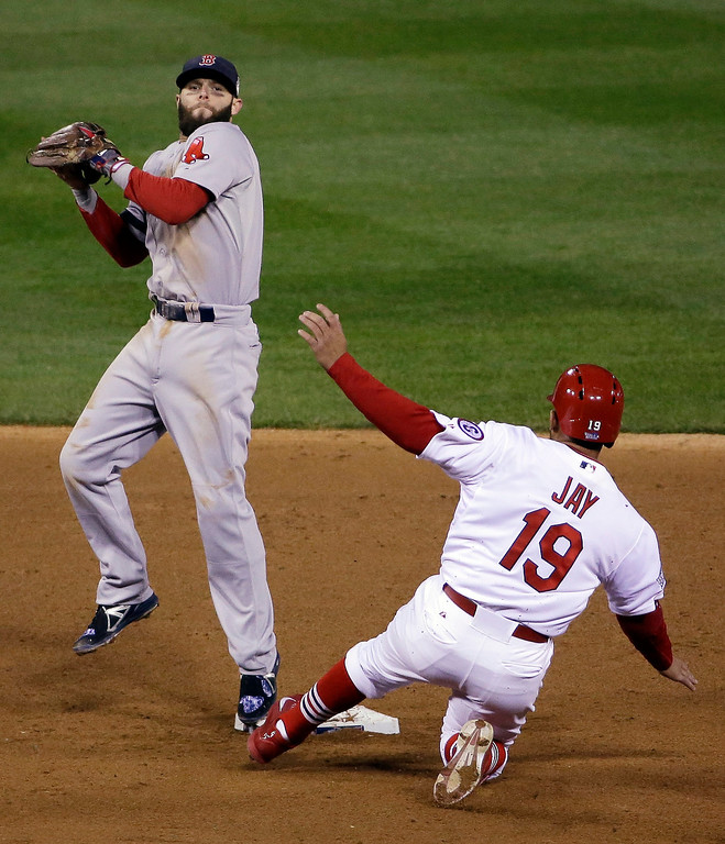 . Boston Red Sox\'s Dustin Pedroia leaps over St. Louis Cardinals\' Jon Jay as he tries to turn a double play during the fourth inning of Game 4 of baseball\'s World Series Sunday, Oct. 27, 2013, in St. Louis. David Freese beat the throw to first. (AP Photo/David J. Phillip)