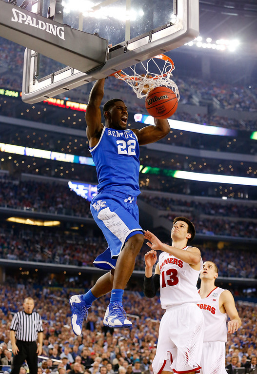 . ARLINGTON, TX - APRIL 05:  Alex Poythress #22 of the Kentucky Wildcats dunks as Duje Dukan #13 of the Wisconsin Badgers defends during the NCAA Men\'s Final Four Semifinal at AT&T Stadium on April 5, 2014 in Arlington, Texas.  (Photo by Tom Pennington/Getty Images)
