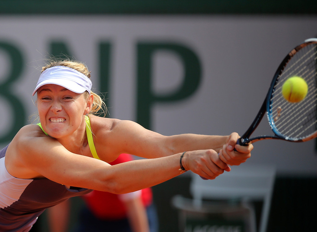 . Russia\'s Maria Sharapova returns the ball to Serena Williams, of the U.S, during the Women\'s final match of the French Open tennis tournament at the Roland Garros stadium Saturday, June 8, 2013 in Paris. (AP Photo/Michel Euler)