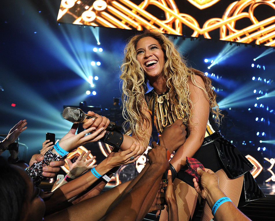 """. Singer Beyonce performs on her \""""Mrs. Carter Show World Tour 2013\"""", on Saturday June 29, 2013, in Las Vegas, Nevada. (Photo by Frank Micelotta/Invision for Parkwood Entertainment/AP Images)"""