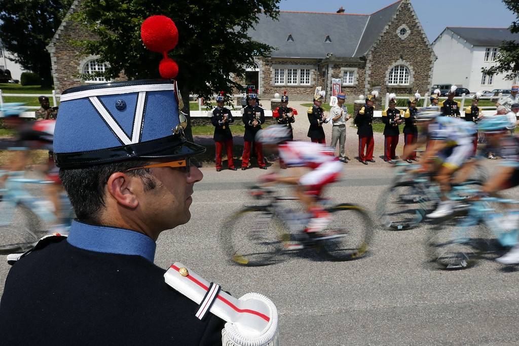 . Members of  the Ecole Speciale Militaire de Saint-Cyr (Special Military School of Saint-Cyr) stand along the road as cyclists ride past during the 197 km tenth stage of the 100th edition of the Tour de France cycling race on July 9, 2013 between Saint-Gildas-des-Bois and Saint-Malo, northwestern France.     JOEL SAGET/AFP/Getty Images