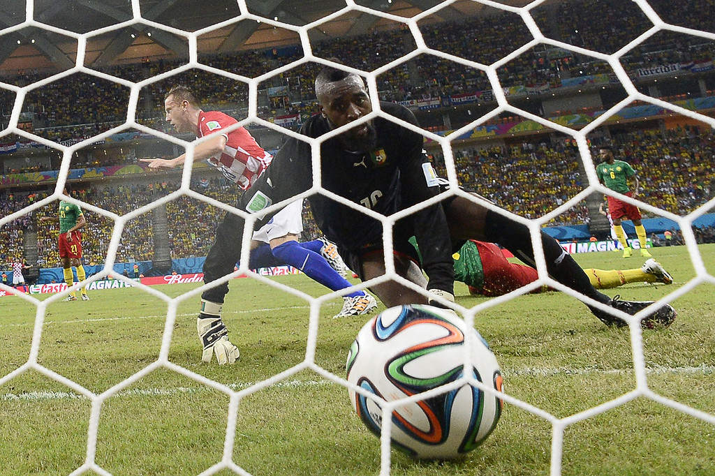 . Cameroon\'s goalkeeper Charles Itandje (front) looks at the ball after Croatia\'s forward Ivica Olic scores, during a Group A football match between Cameroon and Croatia in the Amazonia Arena in Manaus during the 2014 FIFA World Cup on June 18, 2014.  PIERRE-PHILLIPPE MARCOU/AFP/Getty Images