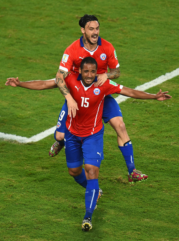 . Mauricio Pinilla of Chile celebrates his teams third goal scored by Jean Beausejour (15) during the 2014 FIFA World Cup Brazil Group B match between Chile and Australia at Arena Pantanal on June 13, 2014 in Cuiaba, Brazil.  (Photo by Stu Forster/Getty Images)