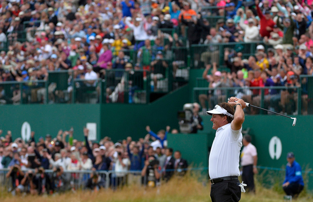 . Phil Mickelson of the U.S. reacts after making his birdie putt on the 18th green during the final round of the British Open golf championship at Muirfield in Scotland July 21, 2013    REUTERS/Toby Melville