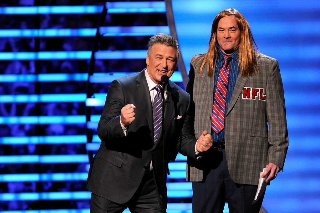. Host Alec Baldwin, left, and comedian David Koechner speak on stage at the third annual NFL Honors at Radio City Music Hall on Saturday, Feb. 1, 2014, in New York. (Photo by Evan Agostini/Invision for NFL/AP Images)