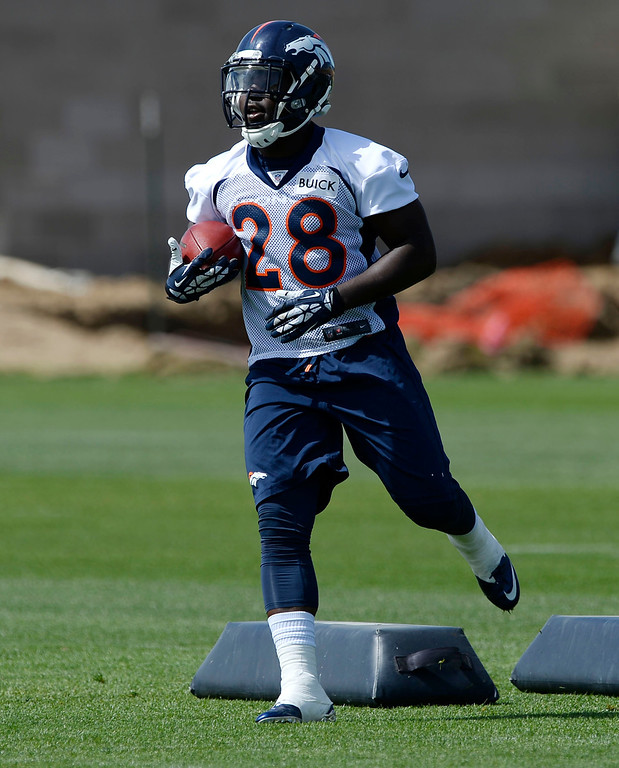 . Denver Broncos RB Montee Ball (28) runs through drills during OTAs June 16, 2014 at Dove Valley. (Photo by John Leyba/The Denver Post)