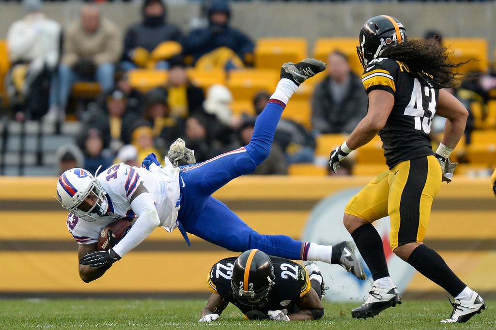 . Buffalo Bills\' Stevie Johnson (13) is sent flying by a Pittsburgh Steelers\' William Gay (22) as Troy Polamalu (43) looks on during the second half of an NFL football game, Sunday, Nov. 10, 2013, in Pittsburgh. (AP Photo/Don Wright)