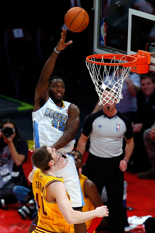 . HOUSTON, TX - FEBRUARY 15:  Kenneth Faried #35 of the Denver Nuggets and Team Chuck shoots over Tyler Zeller #40 of the Cleveland Cavaliers and Team Shaq in the BBVA Rising Stars Challenge 2013 part of the 2013 NBA All-Star Weekend at the Toyota Center on February 15, 2013 in Houston, Texas.  (Photo by Scott Halleran/Getty Images)