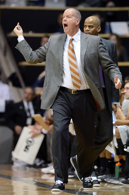 . CU coach Tad Boyle works against Cal during the first half of the January 27th, 2013 game in Boulder. Cliff Grassmick/The Daily Camera