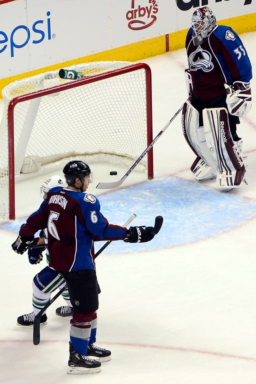 . DENVER, CO - MARCH 24: Jean-Sebastien Giguere (35) of the Colorado Avalanche reacts to giving up a 3-1 goal to Alex Burrows (14) of the Vancouver Canucks during the second period of action. Colorado Avalanche versus the Vancouver Canucks at the Pepsi Center. (Photo by AAron Ontiveroz/The Denver Post)