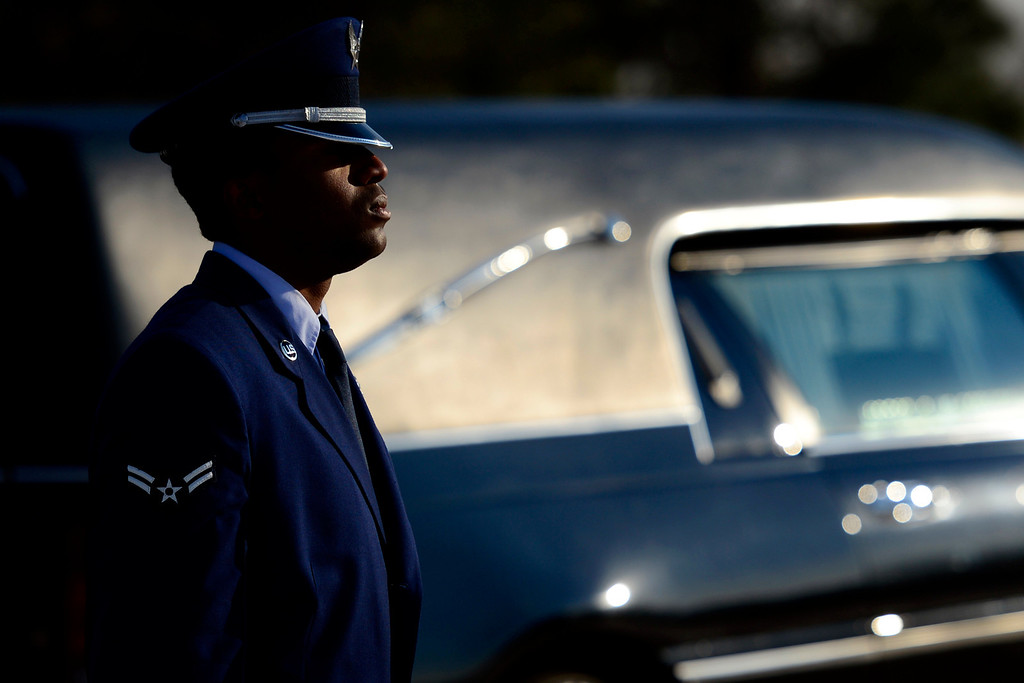 . An Honor Guard member stands at attention during the funeral service for Colonel Fitzroy Newsum at Fort Logan National Cemetery on Monday, January 14, 2013. Newsum, who was 94, served as a Tuskegee Airman during his military service. AAron Ontiveroz, The Denver Post