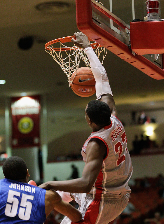 . Houston\'s forward Danuel House (23) dunks on Memphis\'  Geron Johnson (55)  during the second half of an NCAA college basketball game, Thursday, Feb. 27, 2014, in Houston. Houston won 77-68. (AP Photo/Bob Levey)