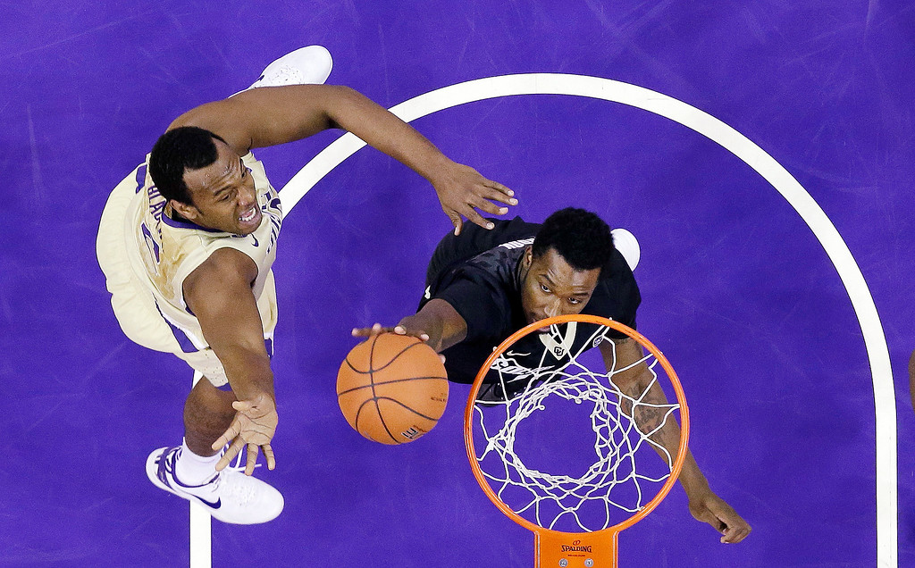 . Colorado\'s Wesley Gordon, right, knocks away a shot by Washington\'s Perris Blackwell in the first half of an NCAA college basketball game on Sunday, Jan. 12, 2014, in Seattle. (AP Photo/Elaine Thompson)