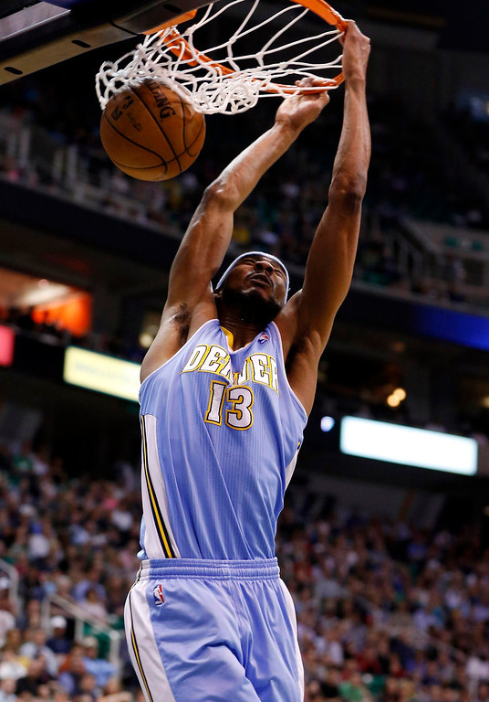 . Denver Nuggets forward Corey Brewer (13) gets a dunk against the Utah Jazz during the first half of their NBA basketball game in Salt Lake City, Utah, April 3, 2013. REUTERS/Jim Urquhart