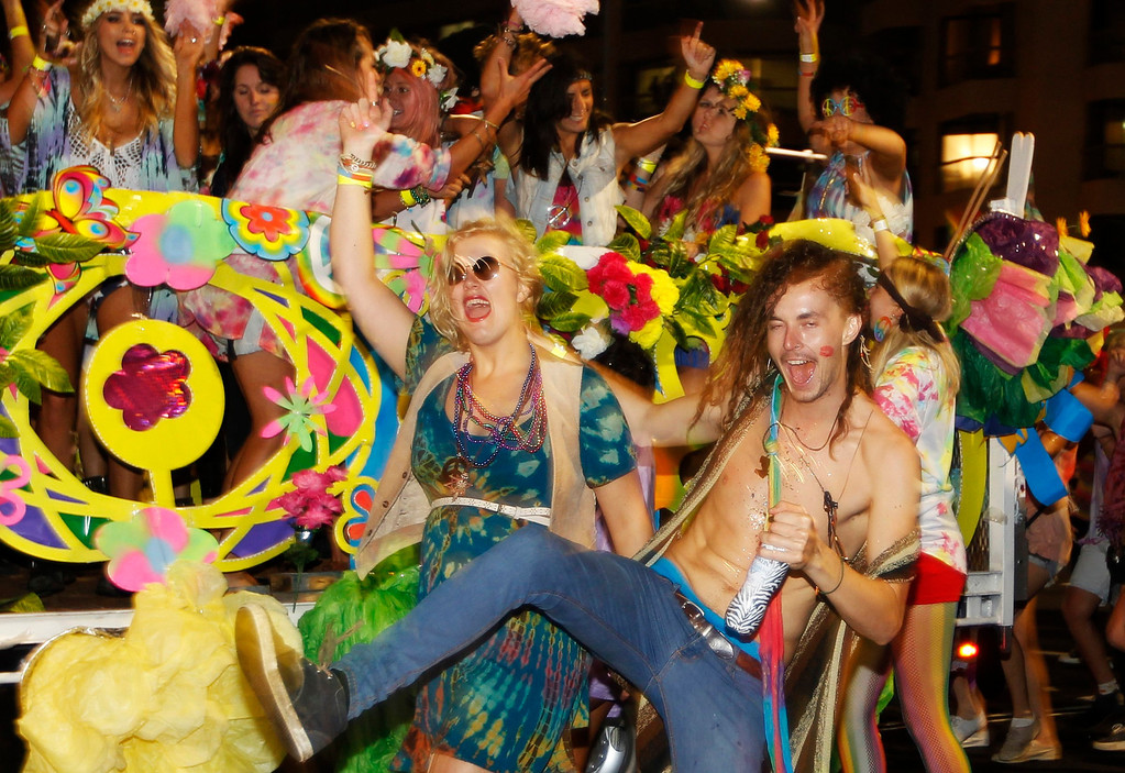 ". Members of the group ""Snatch and Grab\"" participate in the 35th annual Sydney Gay and Lesbian Mardi Gras parade March 2, 2013. REUTERS/Daniel Munoz"