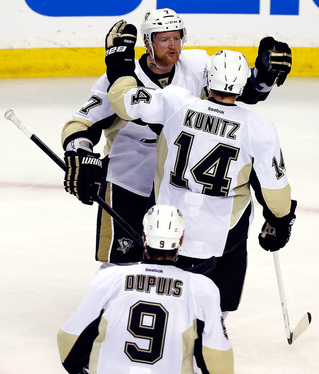 . Chris Kunitz #14 of the Pittsburgh Penguins celebrates a second period goal with Paul Martin #7 against the Boston Bruins during Game Three of the Eastern Conference Final of the 2013 NHL Stanley Cup Playoffs at the TD Garden on June 5, 2013 in Boston, Massachusetts.  (Photo by Jared Wickerham/Getty Images)