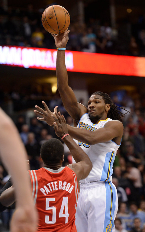 . DENVER, CO. - JANUARY 30: Denver Nuggets small forward Kenneth Faried (35) takes a shot over Houston Rockets power forward Patrick Patterson (54) during the first quarter January 30, 2013 at Pepsi Center. The Denver Nuggets take on the Houston Rockets in NBA action. (Photo By John Leyba/The Denver Post)