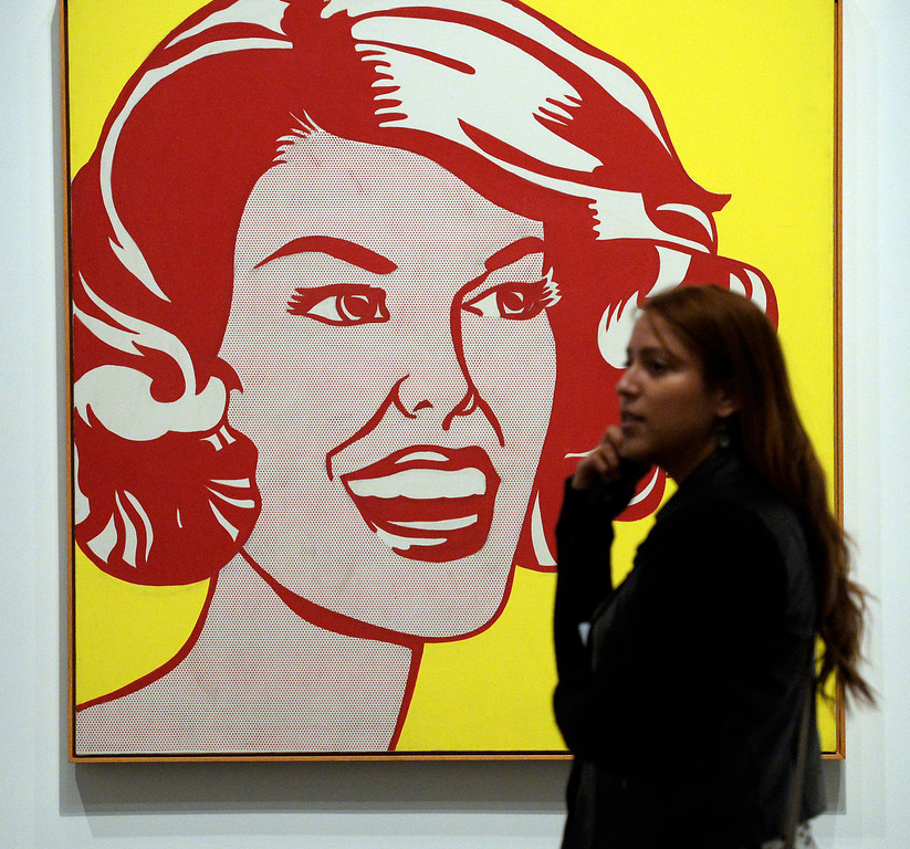 ". Shirly Pezo of Washington D.C.  walks past the Roy Lichtenstein\'s painting ""Head - Red and Yellow\"" at  the Denver Art Museum\'s new exhibition, \""Modern Masters: 20th Century Icons from the Albright-Knox Art Gallery\""  on Wednesday, March 5,  2014. The exhibit brings to the space some of the art world\'s most recognizable names. Picasso, Van Gogh, Warhol,    (Denver Post Photo by Cyrus McCrimmon)"