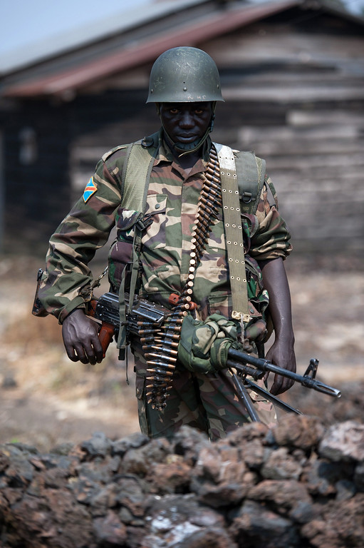 . A Congolese army soldier stands for a photograph at a foward position in Kanyarucinya, around 12 kms from Goma in the east of the Democratic Republic of the Congo, on July 16, 2013. The army in the Democratic Republic of Congo on July 16 pursued an offensive against rebels of the M23 movement to protect the North Kivu provincial capital of Goma. M23, a movement launched by Tutsi defectors from the army who accuse the Kinshasa government of reneging on a 2009 peace deal, last year occupied Goma for 10 days before pulling out under international pressure.  PHIL MOORE/AFP/Getty Images