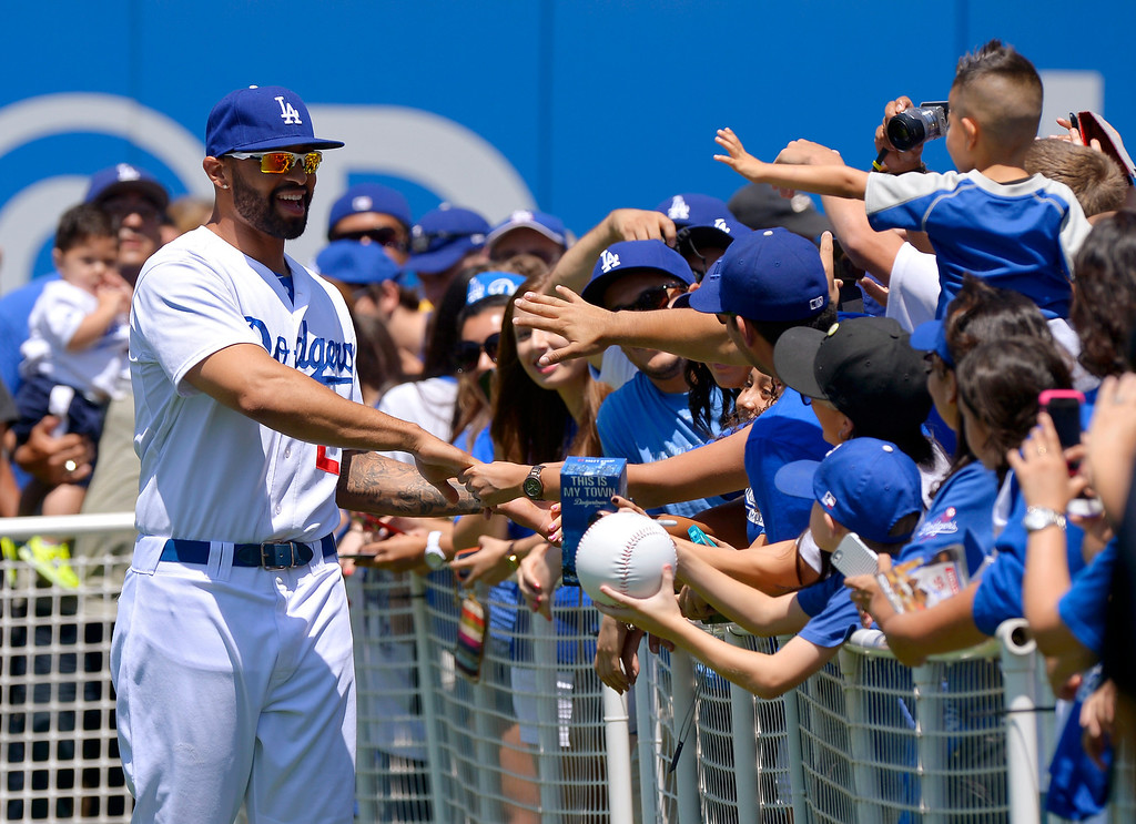 . Los Angeles Dodgers\' Matt Kemp poses for pictures during On-Field Photo Day prior to the Dodgers\' baseball game against the Colorado Rockies, Saturday, July 13, 2013, in Los Angeles.  (AP Photo/Mark J. Terrill)