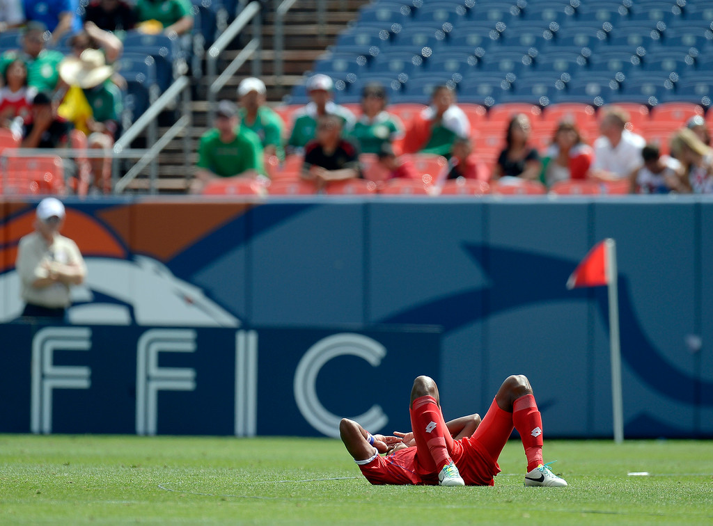 . Jean Carlos Cedeno #13 of Panama  lays on the field after their game against Canada that ended in a tie 0-0 during the CONCACAF Gold Cup soccer game July 14, 2013 at Sports Authority Field at Mile High. (Photo By John Leyba/The Denver Post)