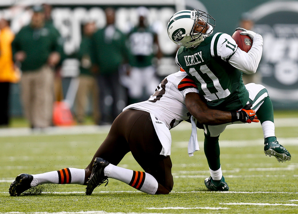 . EAST RUTHERFORD, NJ - DECEMBER 22:   Jeremy Kerley #11 of the New York Jets tries to break away from Tashaun Gipson #39 of the Cleveland Browns during their game at MetLife Stadium on December 22, 2013 in East Rutherford, New Jersey.  (Photo by Jeff Zelevansky/Getty Images)