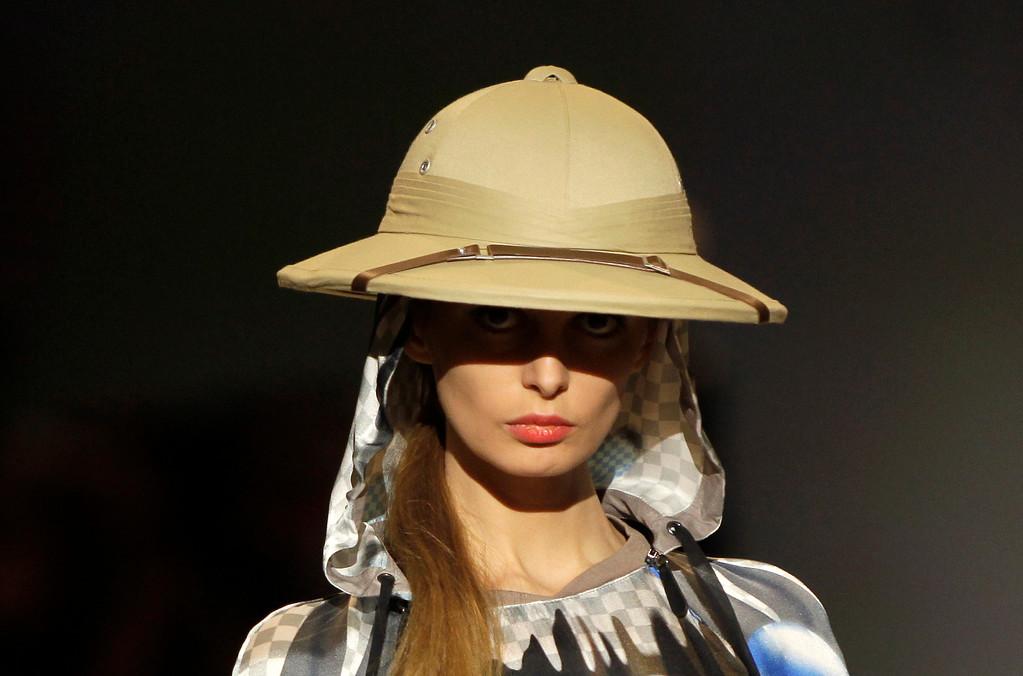 . A model displays outfits by Ukrainian designer Elena Golets during fashion week in Kiev, Ukraine, Sunday, Oct. 13, 2013. (AP Photo/Sergei Chuzavkov)
