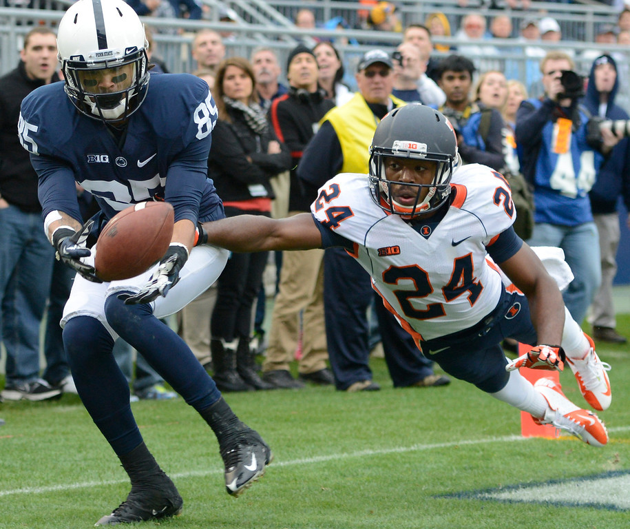 . Illinois defensive back Darius Mosely (24) breaks up a pass in the end zone intended for Penn State wide receiver Brandon Felder (85) in the final minute of an NCAA college football game in State College, Pa., Saturday, Nov. 2, 2013. Penn State won the game 24-17 in overtime. (AP Photo/John Beale)