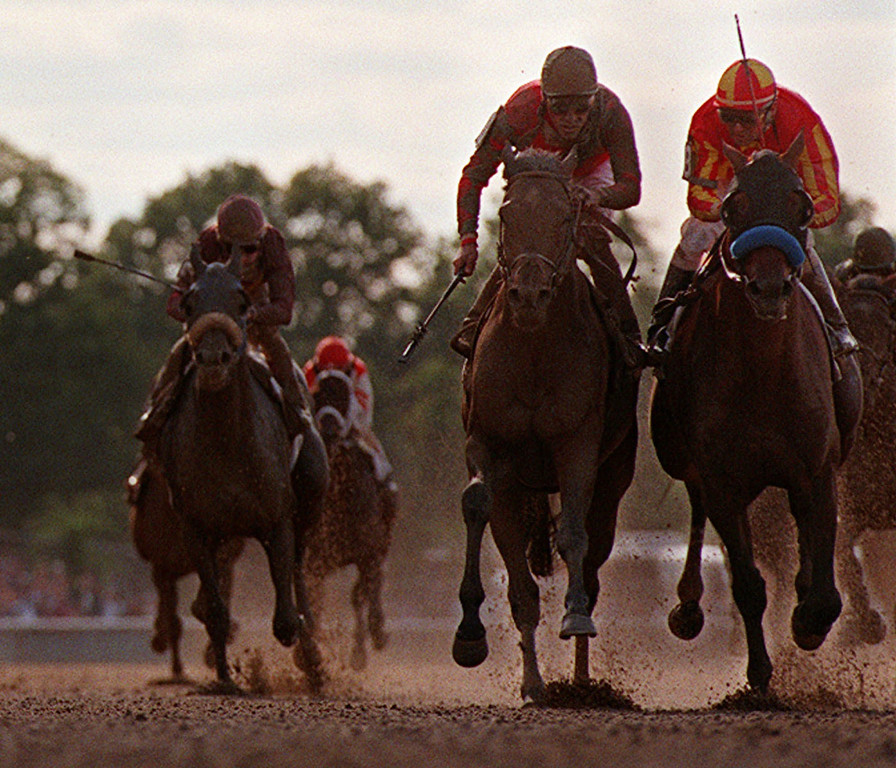 . Real Quiet, with Kent Desormeaux up, right, and Victory Gallop, with Gary Stevens up, second from right, charge for the finish line during the 130th running of the Belmont Stakes at Belmont Park in Elmont, N.Y., Saturday, June 6, 1998. Victory Gallop edged out Kentucky Derby and Preakness winner Real Quiet to win the race in a photo finish. Third place finisher Thomas Jo, with Chris McCarron up, is at left. (AP Photo/Charles Krupa)