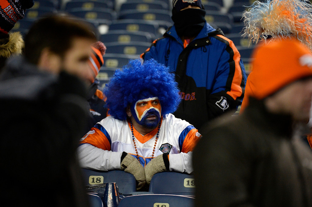 . DENVER, CO - DECEMBER 12: Denver Broncos fans watch as the game winds down the  Broncos lost to the Chargers 27 -20. The Denver Broncos vs. the San Diego Chargers at Sports Authority Field at Mile High in Denver on December 12, 2013. (Photo by John Leyba/The Denver Post)