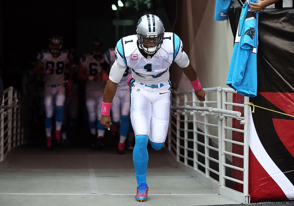. Quarterback Cam Newton #1 of the Carolina Panthers runs out onto the field with teammates before the NFL game against the Arizona Cardinals at the University of Phoenix Stadium on October 6, 2013 in Glendale, Arizona.  (Photo by Christian Petersen/Getty Images)