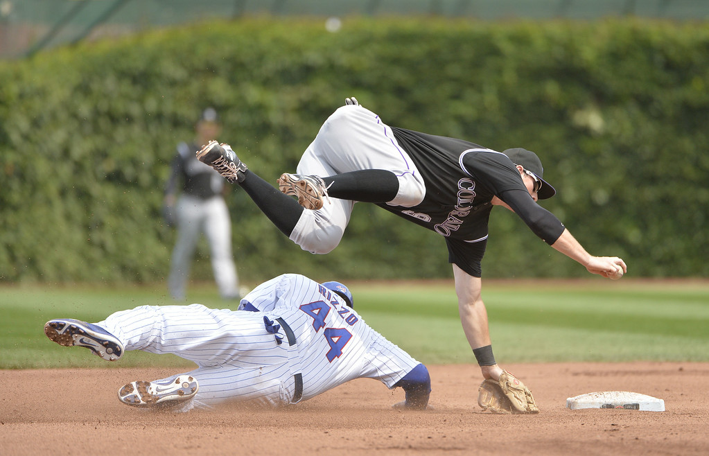 . Anthony Rizzo #44 of the Chicago Cubs (L) slides into second baseman D.J. LeMahieu #9 of the Colorado Rockies to break up a double play on a ground ball hit by Starlin Castro during the fourth inning at Wrigley Field on July 31, 2014 in Chicago, Illinois.  (Photo by Brian Kersey/Getty Images)