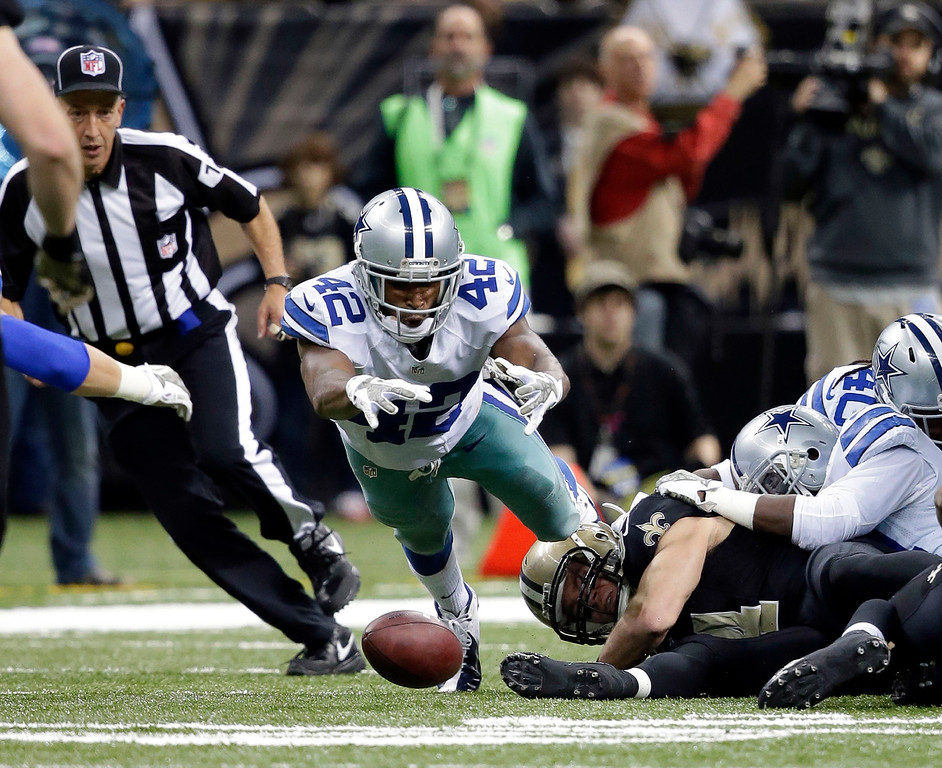 . Dallas Cowboys free safety Barry Church (42) dives to recover a kick in the second half of an NFL football game against the New Orleans Saints in New Orleans, Sunday, Nov. 10, 2013. (AP Photo/Dave Martin)