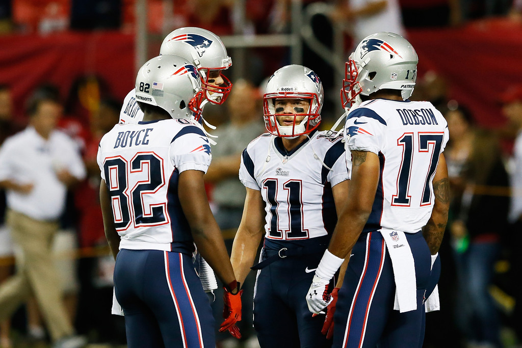 . Tom Brady #12,  Josh Boyce #82,  Julian Edelman #11 and  Aaron Dobson #17 of the New England Patriots talk during their game against the Atlanta Falcons at Georgia Dome on September 29, 2013 in Atlanta, Georgia.  (Photo by Kevin C. Cox/Getty Images)