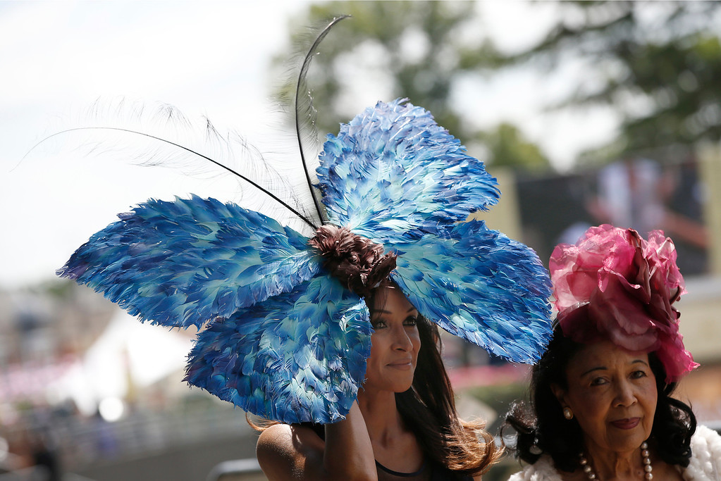 . A race goer wears a butterfly design ornate hat on the first day of the Royal Ascot horse racing meeting at Ascot, England, Tuesday, June 17, 2014.   (AP Photo/Alastair Grant)