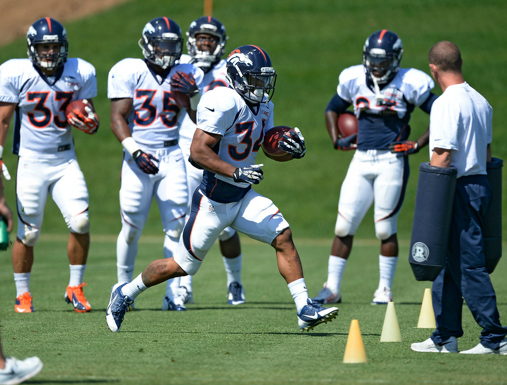 . Denver Broncos running back Brennan Clay (34) runs through drills during practice at the Denver Broncos 2014 training camp August 11, 2014 at Dove Valley. (Photo by John Leyba/The Denver Post)