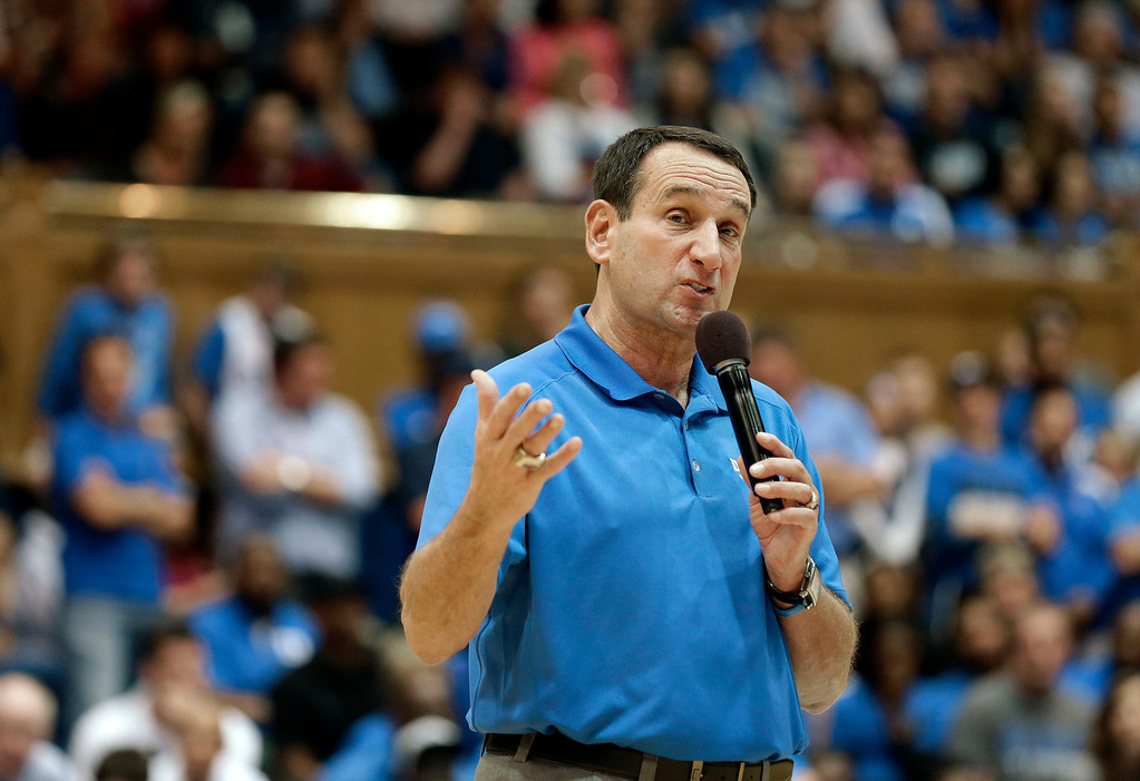 . Duke coach Mike Krzyzewski speaks with fans during the team\'s Countdown to Craziness NCAA college basketball preseason event in Durham, N.C., Friday, Oct. 18, 2013. (AP Photo/Gerry Broome)