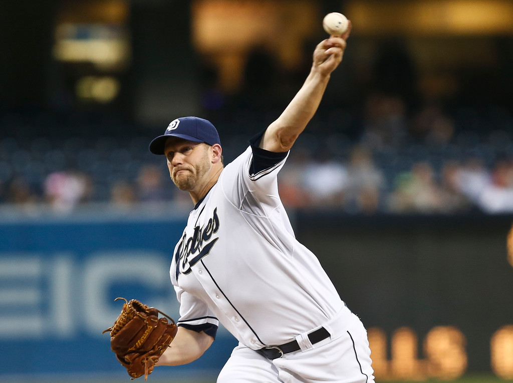. San Diego Padres starting pitcher Eric Stults works against the Colorado Rockies in the first inning of a baseball game Monday, April 14, 2014, in San Diego. (AP Photo/Lenny Ignelzi)
